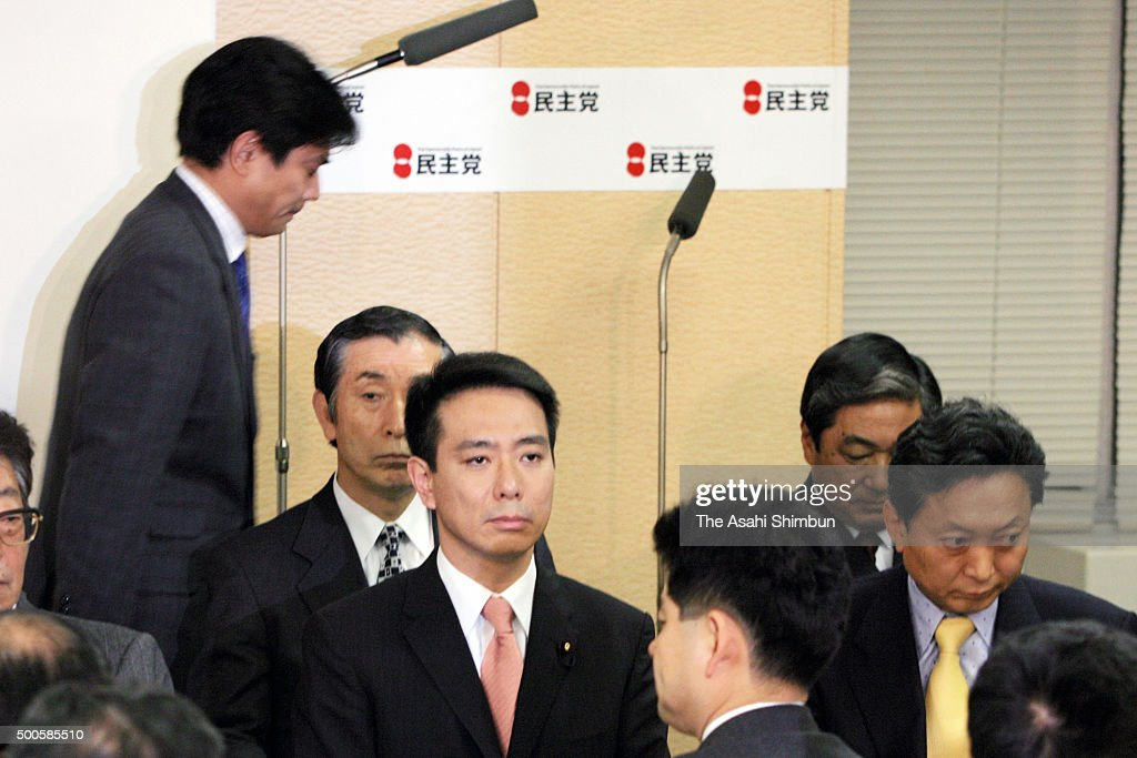 Opposition Democratic Party of Japan lawmaker Hisayasu Nagata leaves the room walking past DPJ President Seiji Maehara and secretary general Yukio Hatoyama after apologising during the DPJ lawmakers' meeting on February 28, 2006 in Tokyo, Japan.