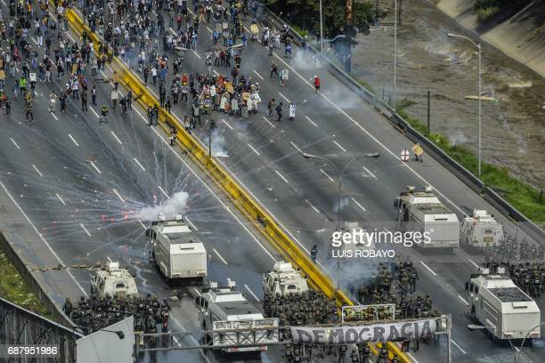 TOPSHOT Opposition demonstrators clash with riot police during a protest in Caracas on May 24 2017 Venezuela's President Nicolas Maduro formally...