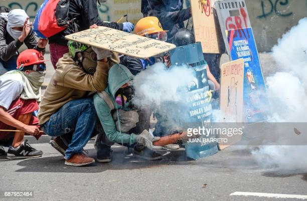 TOPSHOT Opposition demonstrators clash with the police during a protest in Caracas on May 24 2017 Venezuela's President Nicolas Maduro formally...