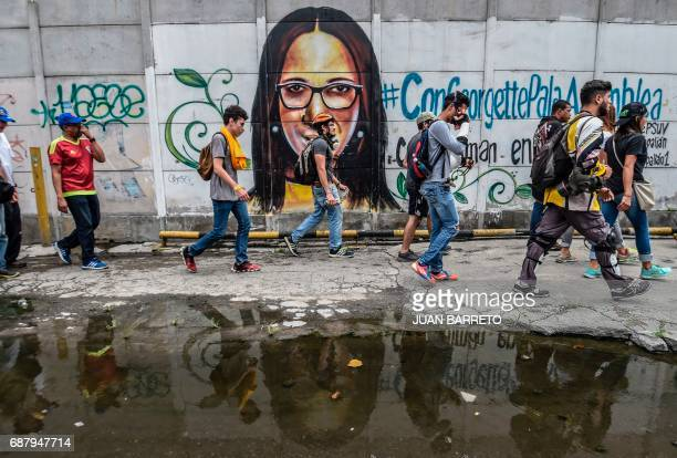 TOPSHOT Opposition demonstrators take part in a march against President Nicolas Maduro in Caracas on May 24 2017 Venezuela's President Nicolas Maduro...