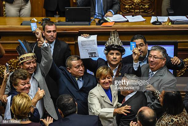 Opposition deputies of Amazonas state Julio Ygarza Romel Guzamana and Nirma Guaruya celebrate after took office in the National Assembly in Caracas...