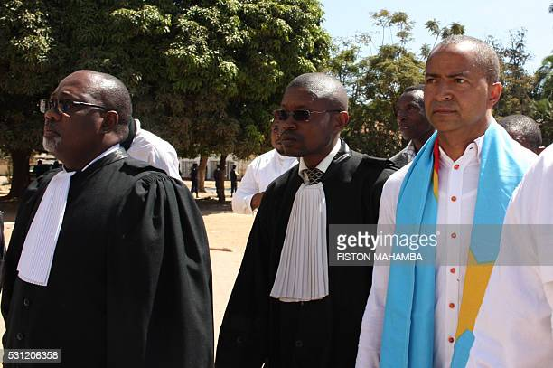 Opposition figure Moise Katumbi arrives the courthouse with his lawyers in Lubumbashi on May 13 2016 Police in DR Congo fired tear gas today to break...