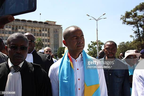Opposition figure Moise Katumbi arrives with his lawyer at the courthouse in Lubumbashi on May 13 2016 Police in DR Congo fired tear gas today to...