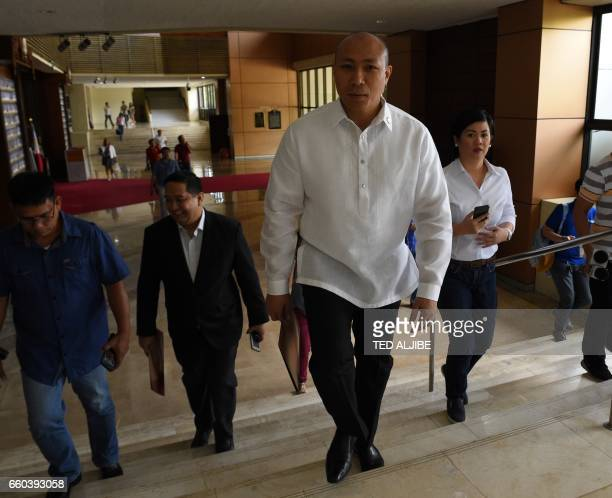 Opposition Filipino lawmaker Gary Alejano a former military officer who joined an uprising against former president Gloria Arroyo in 2003 walks with...
