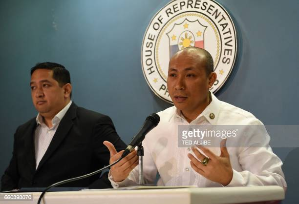 Opposition Filipino lawmaker Gary Alejano a former military officer who joined an uprising against former president Gloria Arroyo in 2003 gestures a...