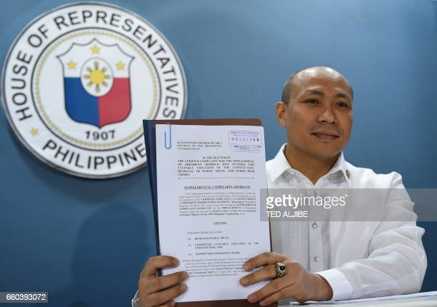 Opposition Filipino lawmaker Gary Alejano a former military officer who joined an uprising against former president Gloria Arroyo in 2003 shows a...