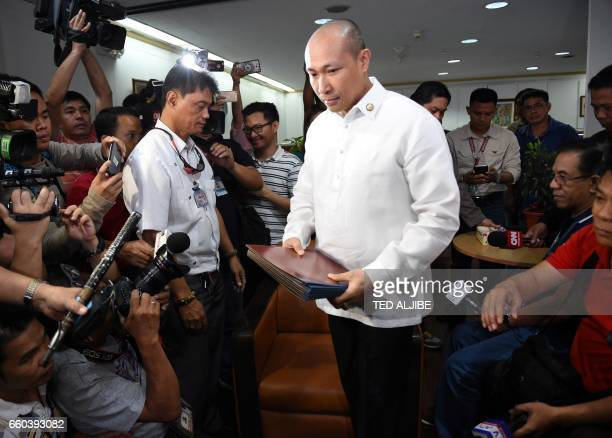 Opposition Filipino lawmaker Gary Alejano a former military officer who joined an uprising against former president Gloria Arroyo in 2003 arrives to...