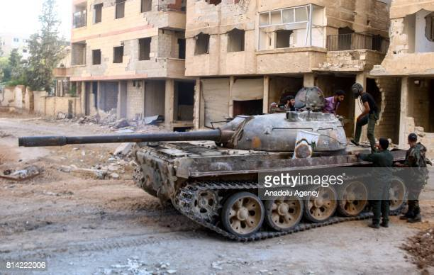 Opposition forces are seen during a clash after Assad Regime's forces hit a deconflict zone of opposition controlled Jobar neighborhood in Damascus...