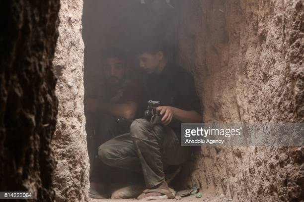 Opposition forces are seen in a bulwark during a clash after Assad Regime's forces hit a deconflict zone of opposition controlled Jobar neighborhood...