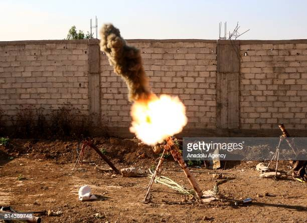 Opposition forces fires a mortar during a clash after Assad Regime's forces hit a deconflict zone of opposition controlled Jobar neighborhood in...