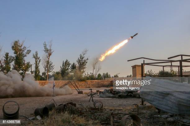 Opposition forces launches a missile during a clash after Assad Regime's forces hit a deconflict zone of opposition controlled Jobar neighborhood in...