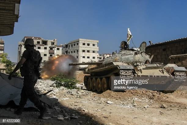 Opposition forces' tank fires during a clash after Assad Regime's forces hit a deconflict zone of opposition controlled Jobar neighborhood in...