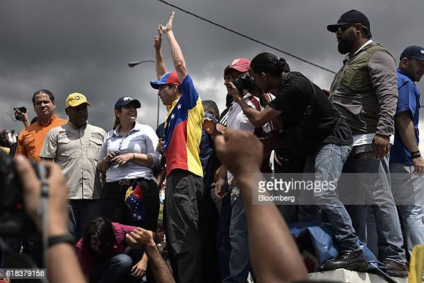 Opposition governor Henrique Capriles center joins demonstrators during a protest against the suspended recall referendum process in Caracas...