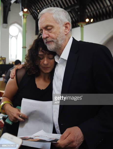 Opposition Labour leader Jeremy Corbyn comforts a local resident at St Clement's Church in west London on June 15 where shelter and support for...