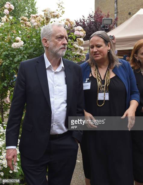 Opposition Labour leader Jeremy Corbyn speaks with Clare Richards Chief Executive of the Clement James Centre as he arrives at St Clement's Church in...