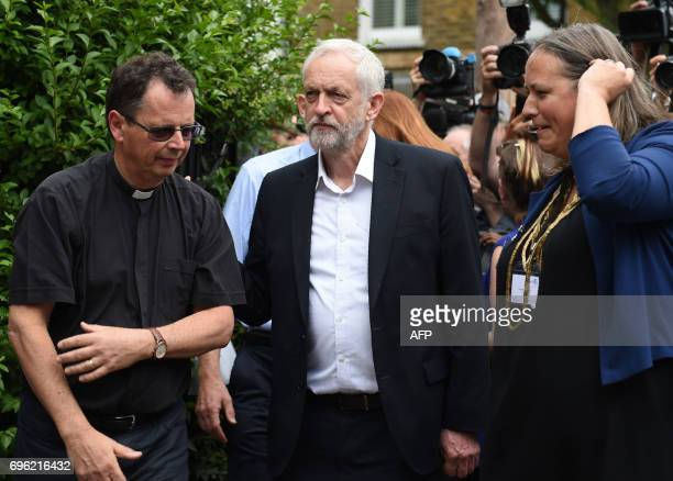 Opposition Labour party leader Jeremy Corbyn arrives to meet staff and volunteers at St Clement's Church in west London who have provided shelter and...