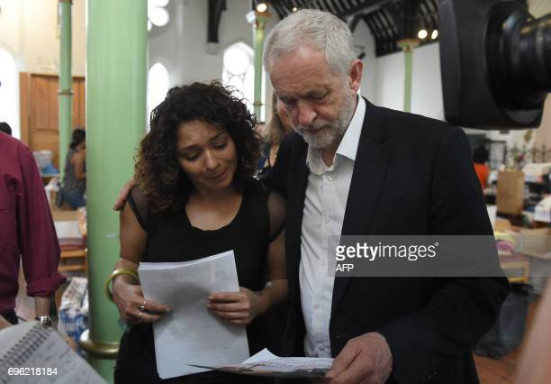 Opposition Labour party leader Jeremy Corbyn comforts a resident at St Clement's Church in west London who have provided shelter and support for...