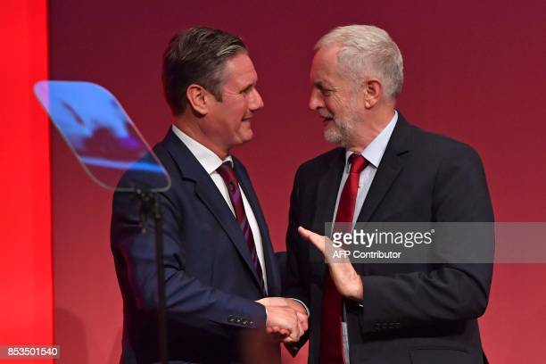 Opposition Labour Party leader Jeremy Corbyn congratulates Opposition Labour Party Shadow Brexit Secretary Keir Starmer after he delivers a speech on...
