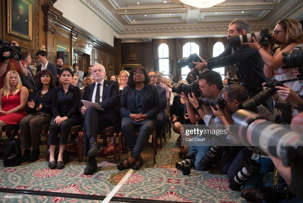 Opposition Labour Party leader Jeremy Corbyn (C) is photographed as he sits with his wife, Laura Alvarez (L); Shadow Attorney General for England and Wales, Shami Chakrabarti (C-L) and Shadow Home Secretary, Diane Abbott (R) as he arrives to make a speech on defence on May 26, 2017 in London, England. Mr Corbyn stated that UK foreign policy would change under a Labour government to one that 'reduces rather than increases the threat' to the country, as election campaigning resumed after the attack in Manchester earlier this week.