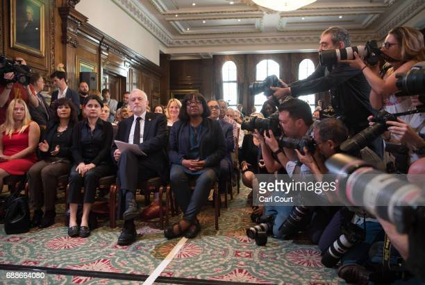 Opposition Labour Party leader Jeremy Corbyn is photographed as he sits with his wife Laura Alvarez Shadow Attorney General for England and Wales...