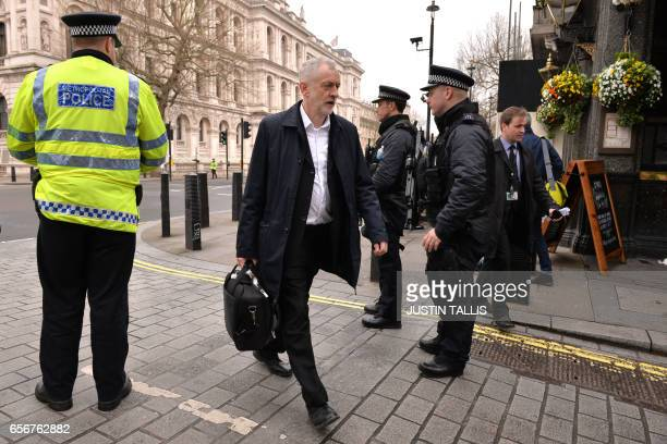 Opposition Labour party leader Jeremy Corbyn walks toward the Houses of Parliament in central London on March 23 2017 Seven people have been arrested...