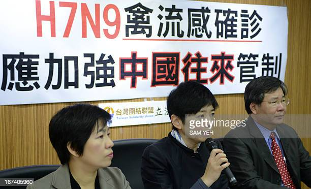 Opposition lawmakers Huang Wenling Lin Shihchia and Hsu Chunghsin from the Taiwan Solidarity Union speak during a press conference calling on the...