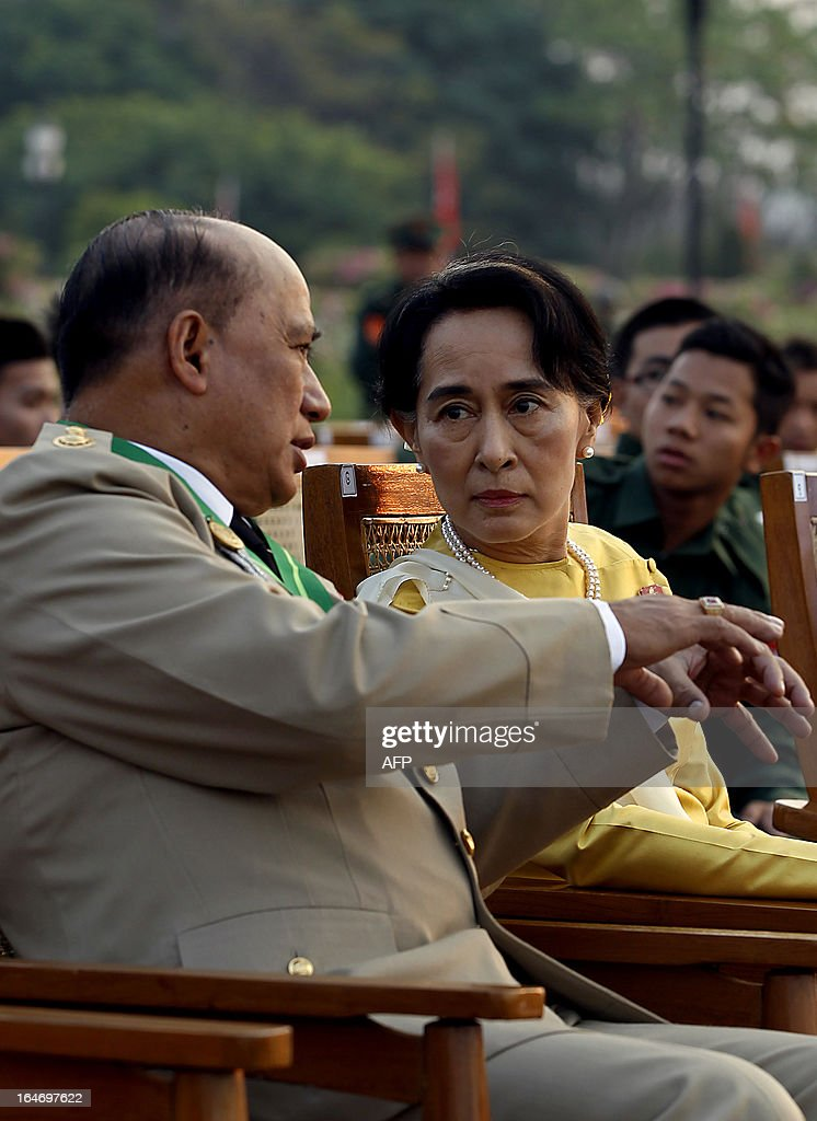Opposition leader <a gi-track='captionPersonalityLinkClicked' href=/galleries/search?phrase=Aung+San+Suu+Kyi&family=editorial&specificpeople=214208 ng-click='$event.stopPropagation()'>Aung San Suu Kyi</a> (R) speaks with Major General Zaw Win (L), Deputy Minister for Border Affairs, during a ceremony marking Myanmar's 68th Armed Forces Day at a parade ground in Naypyidaw on March 27, 2013. Suu Kyi attended Myanmar's Armed Forces Day for the first time.