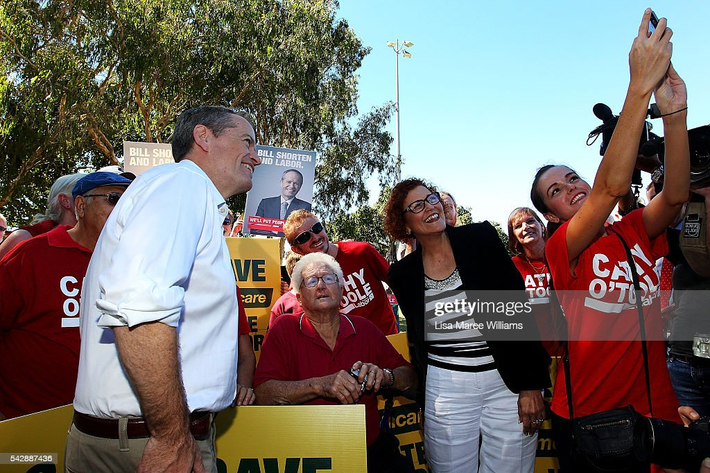 Opposition Leader, Australian Labor Party <a gi-track='captionPersonalityLinkClicked' href=/galleries/search?phrase=Bill+Shorten&family=editorial&specificpeople=606712 ng-click='$event.stopPropagation()'>Bill Shorten</a> and Cathy O'Toole greet with supporters at The Strand on June 24, 2016 in Townsville, Australia. <a gi-track='captionPersonalityLinkClicked' href=/galleries/search?phrase=Bill+Shorten&family=editorial&specificpeople=606712 ng-click='$event.stopPropagation()'>Bill Shorten</a> is campaigning heavily on Medicare, promising to make sure it isn't privatised if the Labor Party wins the Federal Election on July 2.
