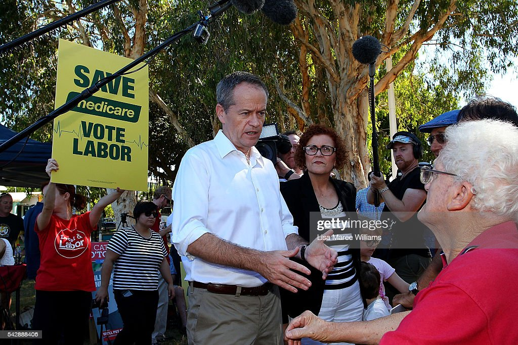 Opposition Leader, Australian Labor Party <a gi-track='captionPersonalityLinkClicked' href=/galleries/search?phrase=Bill+Shorten&family=editorial&specificpeople=606712 ng-click='$event.stopPropagation()'>Bill Shorten</a> and Cathy O'Toole speak with supporters at The Strand on June 24, 2016 in Townsville, Australia. <a gi-track='captionPersonalityLinkClicked' href=/galleries/search?phrase=Bill+Shorten&family=editorial&specificpeople=606712 ng-click='$event.stopPropagation()'>Bill Shorten</a> is campaigning heavily on Medicare, promising to make sure it isn't privatised if the Labor Party wins the Federal Election on July 2.