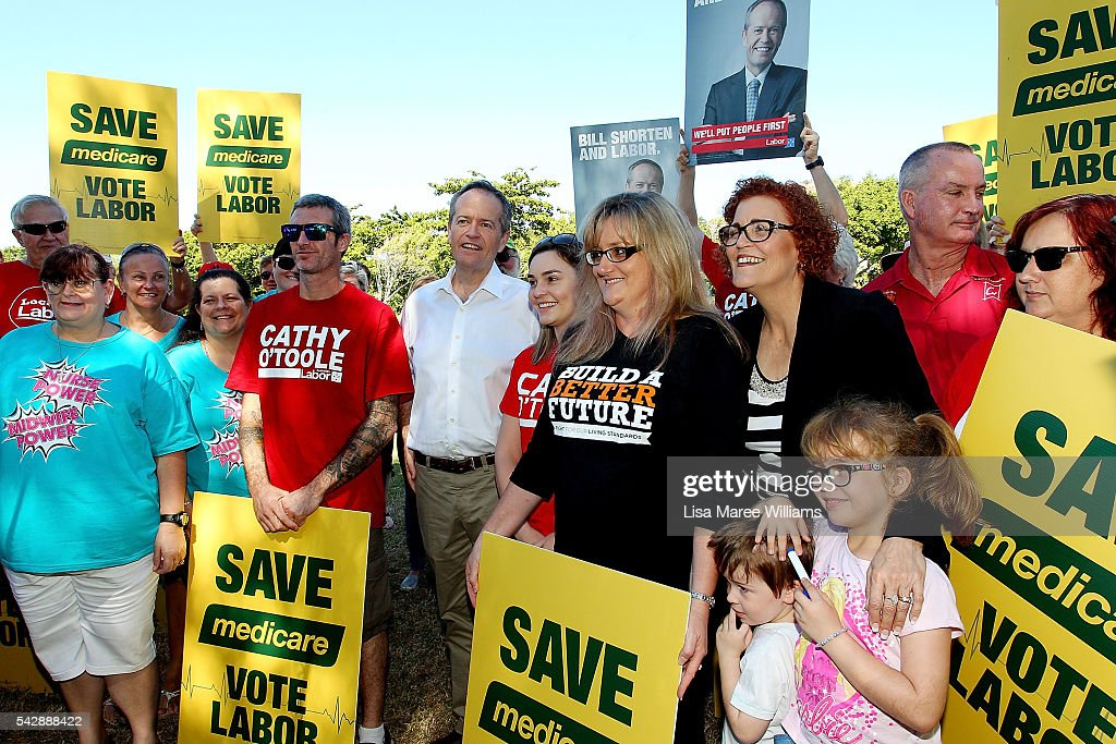 Opposition Leader, Australian Labor Party <a gi-track='captionPersonalityLinkClicked' href=/galleries/search?phrase=Bill+Shorten&family=editorial&specificpeople=606712 ng-click='$event.stopPropagation()'>Bill Shorten</a> (C) and Cathy O'Toole pose with supporters at The Strand on June 24, 2016 in Townsville, Australia. <a gi-track='captionPersonalityLinkClicked' href=/galleries/search?phrase=Bill+Shorten&family=editorial&specificpeople=606712 ng-click='$event.stopPropagation()'>Bill Shorten</a> is campaigning heavily on Medicare, promising to make sure it isn't privatised if the Labor Party wins the Federal Election on July 2.