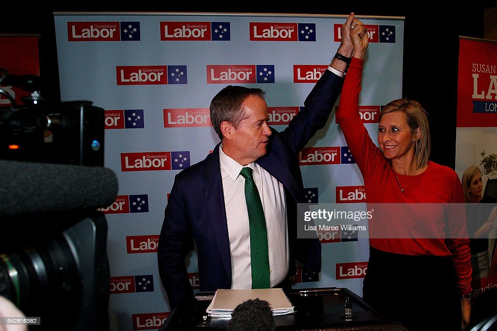 Opposition Leader, Australian Labor Party Bill Shorten and Susan Lamb raise their arms in the air following a visit to the Caboolture RSL on June 25, 2016 in Caboolture, Australia. Bill Shorten launched his positive policies for Queensland including a overhaul of the visa system and continues to campaign heavily on Medicare, promising to make sure it isn't privatised if the Labor Party wins the Federal Election on July 2.