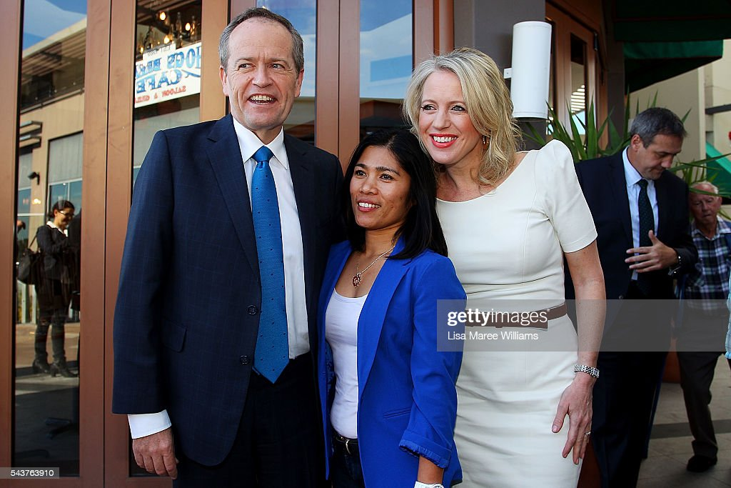 Opposition Leader, Australian Labor Party Bill Shorten and wife Chloe Shorten pose with locals during a visit to the Hyperdome shopping centre on June 30, 2016 in Logan, Australia. Bill Shorten is campaigning heavily on Medicare, promising to make sure it isn't privatised if the Labor Party wins the Federal Election on July 2.