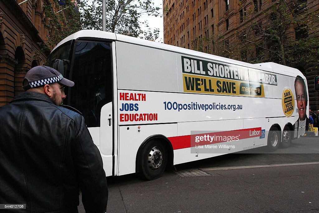Opposition Leader, Australian Labor Party Bill Shorten and wife Chloe Shorten depart a Medicare Rally on the campaign bus from Martin Place on July 1, 2016 in Sydney, Australia.Bill Shorten is campaigning heavily on Medicare, promising to make sure it isn't privatised if the Labor Party wins the Federal Election on July 2.