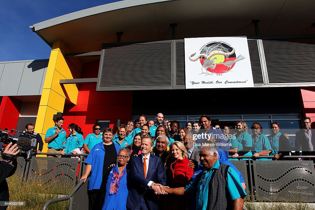 Opposition Leader, Australian Labor Party Bill Shorten and wife Chloe Shorten pose with staff during a visit to the Tharawal Aboriginal Corporation Child and Family Centre in Campbeltown on July 1, 2016 in Sydney, Australia. Bill Shorten is campaigning heavily on Medicare, promising to make sure it isn't privatised if the Labor Party wins the Federal Election on July 2.