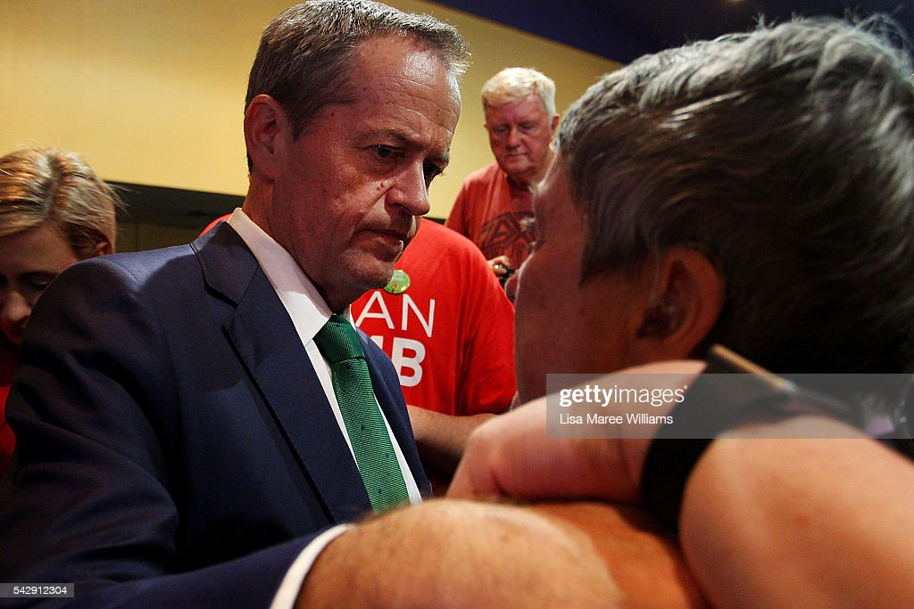 Opposition Leader, Australian Labor Party Bill Shorten comforts a woman during a visit to the Caboolture RSL on June 25, 2016 in Caboolture, Australia. Bill Shorten launched his positive policies for Queensland including a overhaul of the visa system and continues to campaign heavily on Medicare, promising to make sure it isn't privatised if the Labor Party wins the Federal Election on July 2.
