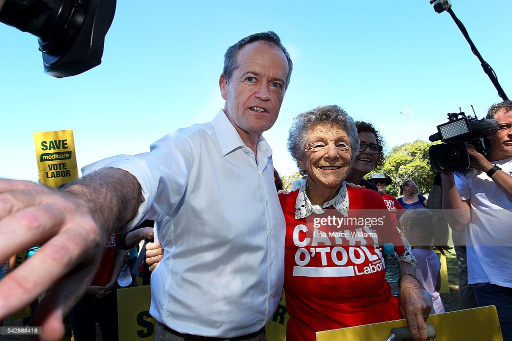 Opposition Leader, Australian Labor Party <a gi-track='captionPersonalityLinkClicked' href=/galleries/search?phrase=Bill+Shorten&family=editorial&specificpeople=606712 ng-click='$event.stopPropagation()'>Bill Shorten</a> speaks puts his arm around a supporter at The Strand on June 24, 2016 in Townsville, Australia. <a gi-track='captionPersonalityLinkClicked' href=/galleries/search?phrase=Bill+Shorten&family=editorial&specificpeople=606712 ng-click='$event.stopPropagation()'>Bill Shorten</a> is campaigning heavily on Medicare, promising to make sure it isn't privatised if the Labor Party wins the Federal Election on July 2.