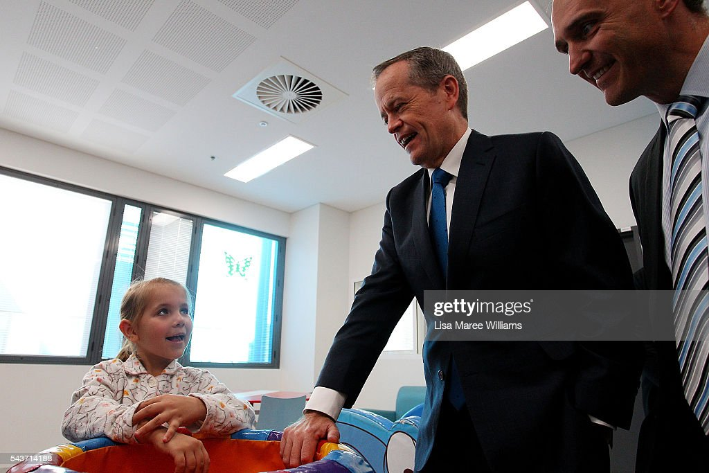 Opposition Leader, Australian Labor Party <a gi-track='captionPersonalityLinkClicked' href=/galleries/search?phrase=Bill+Shorten&family=editorial&specificpeople=606712 ng-click='$event.stopPropagation()'>Bill Shorten</a> visits with Azura Bakker, 7, at the Childrens Ward at Logan Hospital on June 30, 2016 in Logan, Australia. <a gi-track='captionPersonalityLinkClicked' href=/galleries/search?phrase=Bill+Shorten&family=editorial&specificpeople=606712 ng-click='$event.stopPropagation()'>Bill Shorten</a> is campaigning heavily on Medicare, promising to make sure it isn't privatised if the Labor Party wins the Federal Election on July 2. (Photo by Lisa Maree Williams/Getty Images