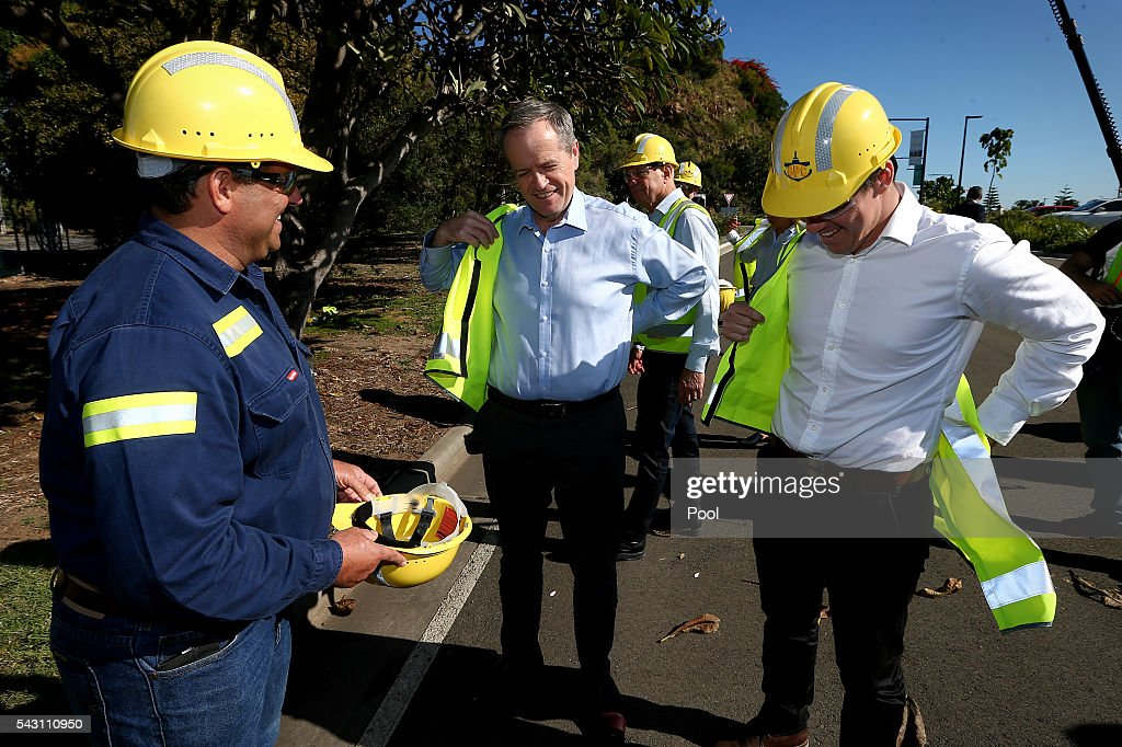 Opposition Leader Bill Shorten (centre) and ALP candidate for Flynn, Zac Beers (right) put on their high visibility vests during a visit to the Gladstone Ports Corporation's Auckland Point Terminal, on June 26, 2016 in Gladstone, Queensland. Shorten continues to campaign leading up to the July 2nd elections. (Photo by Alex Ellinghausen-Pool/Getty Images
