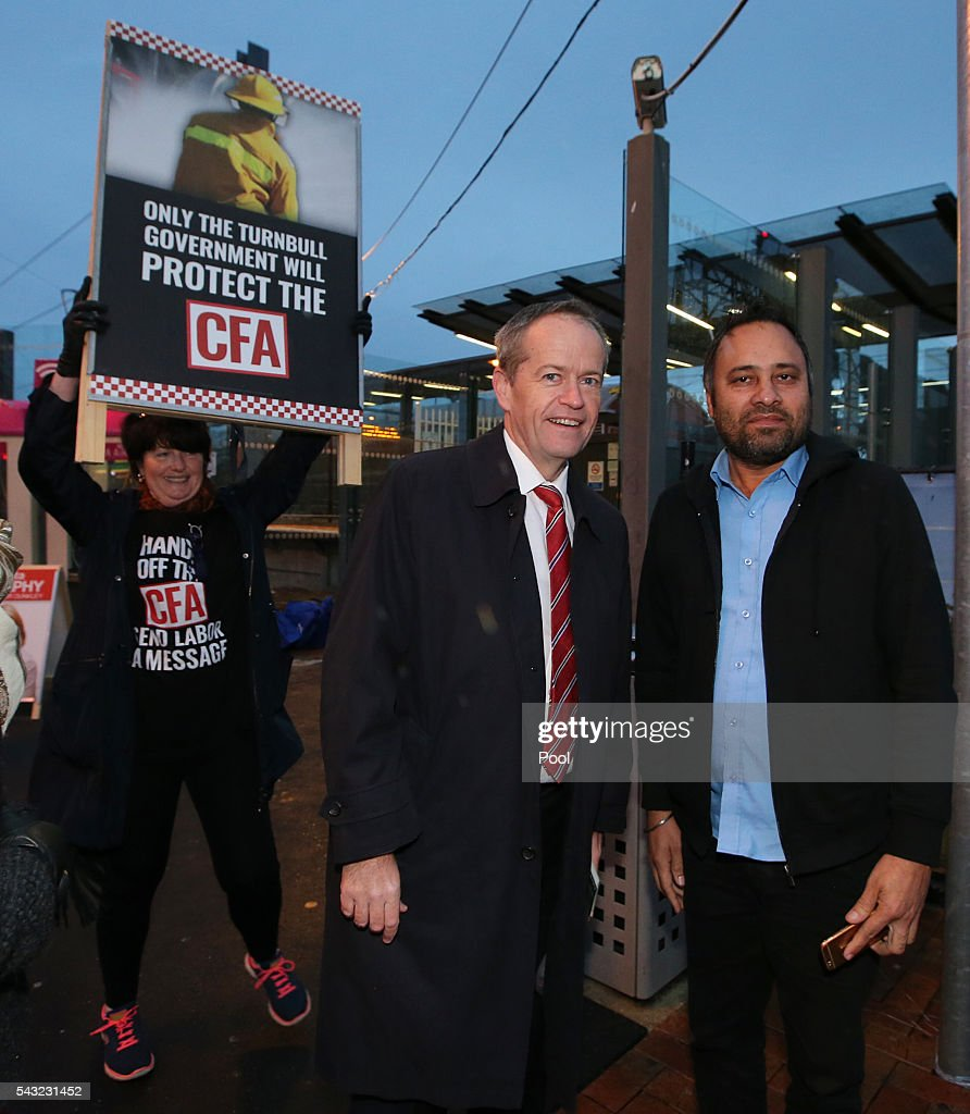 Opposition Leader <a gi-track='captionPersonalityLinkClicked' href=/galleries/search?phrase=Bill+Shorten&family=editorial&specificpeople=606712 ng-click='$event.stopPropagation()'>Bill Shorten</a> poses for a photo at Frankston train station while a liberal volunteer holds up a poster behind him on June 27, 2016 in Melbourne, Australia. The latest Newspoll shows the Coalition has pulled ahead of the Labor Party, less than a week out from the July 2 election. On a two-party preferred basis, the Coalition now leads Labor 51-49, breaking the deadlock from the last poll.