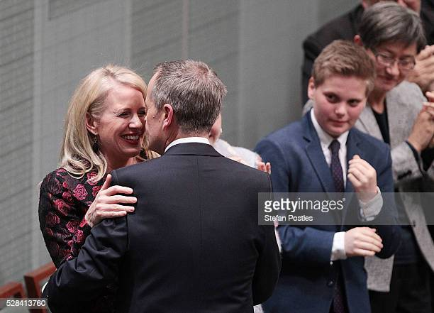 Opposition leader Bill Shorten receives a hug and kiss from his wife Chloe Bryce after delivering his budget reply speech on May 5 2016 in Canberra...