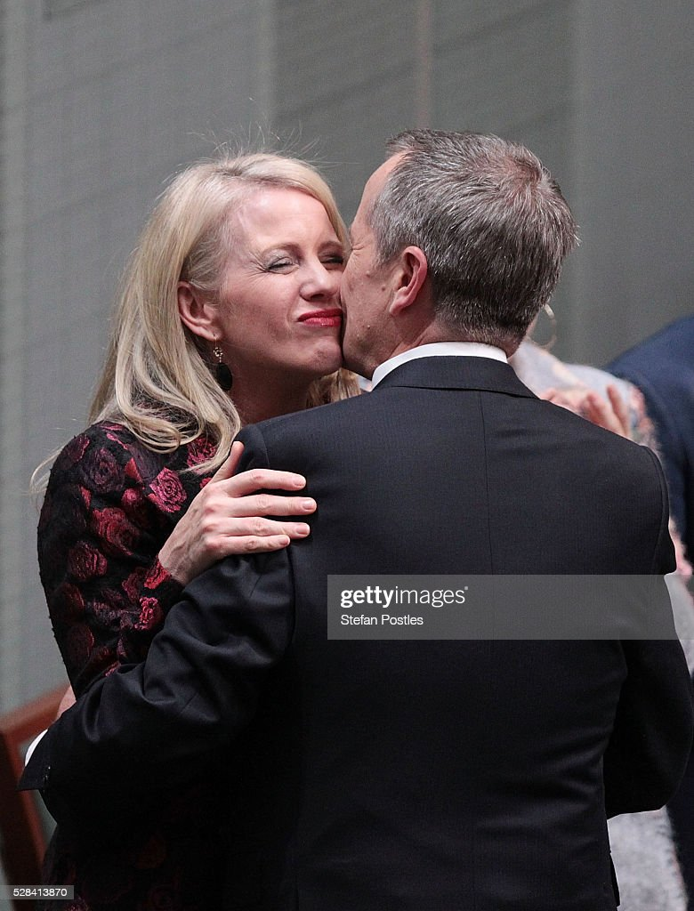 Opposition leader Bill Shorten receives a hug and kiss from his wife Chloe Bryce after delivering his budget reply speech on May 5, 2016 in Canberra, Australia. The Turnbull Government's first budget has delivered tax cuts for small and medium businesses, income tax cuts people earning over $80,000 a year,new measures to help young Australians into jobs and cutbacks to superannuation concessions for the wealthy.