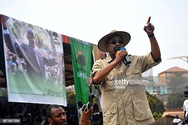 Opposition leader Cellou Dalein Diallo speaks during a rally by opposition parties at the Bonfi stadium in Conackry on January 22 2015 Thousands of...