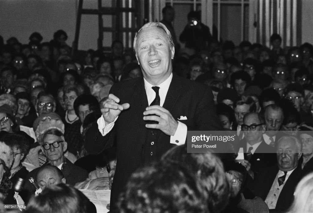Opposition Leader Edward Heath (1916 - 2005) conducting a choir and orchestra at his 26th annual carol concert at Broadstairs in Kent, UK, 14th December 1969.