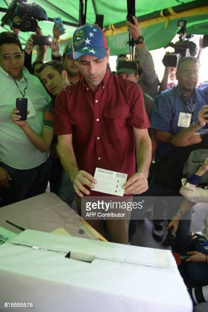 Opposition leader Henrique Capriles casts his vote at a polling station in Caracas on July 16 2017 during an oppositionorganized vote to measure...