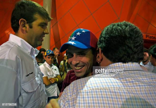Opposition leader Henrique Capriles greets supporters as he arrives at the Democratic Unity Roundtable operations center in Chacao Caracas to wait...
