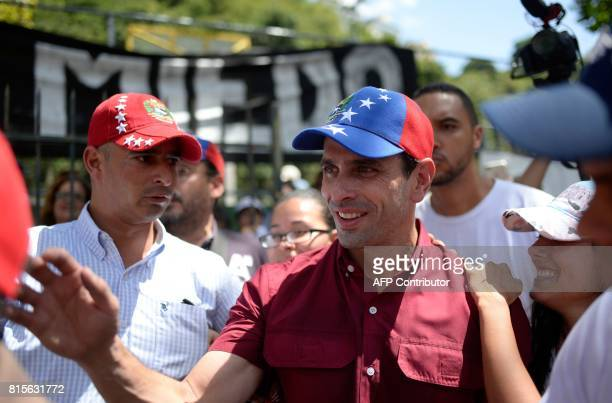 Opposition leader Henrique Capriles greets supporters in Caracas on July 16 2017 during an oppositionorganized vote against Venezuelan President...