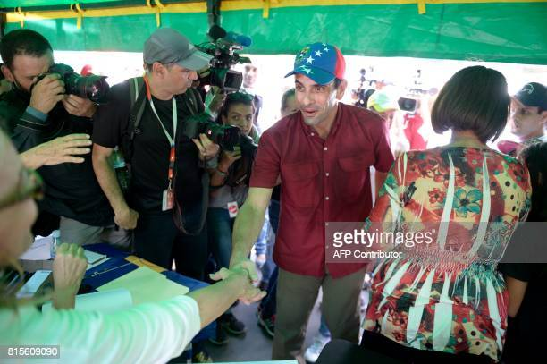 Opposition leader Henrique Capriles is pictured at a polling station in Caracas on July 16 2017 during an oppositionorganized vote against Venezuelan...