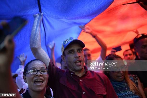 Opposition leader Henrique Capriles is pictured under a Venezuelan national flag in Caracas on July 16 2017 during an oppositionorganized vote...