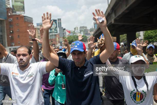 Opposition leader Henrique Capriles reacts to teargas during clashes between protesters and security forces in Caracas today April 19 2017 in Caracas...