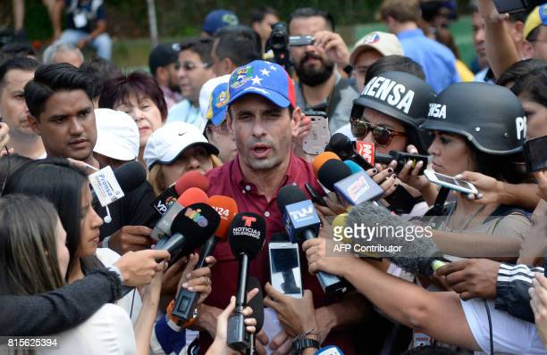 Opposition leader Henrique Capriles speaks to the press at a polling station in Caracas on July 16 2017 during an oppositionorganized vote against...